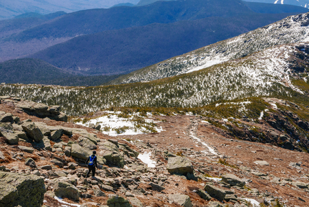 Woman trail running in the White Mountains of New Hampshire