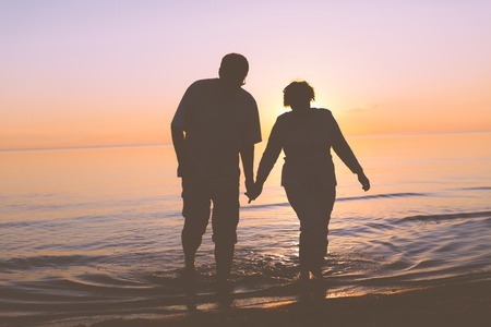 Senior couple walking at sunset Banco de Imagens