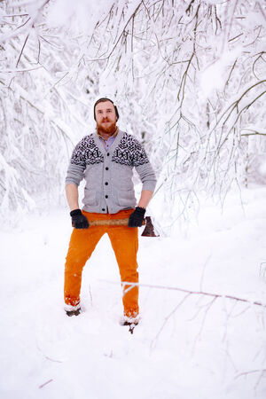 ax man: Lumberjack in the snowy winter forest Stock Photo
