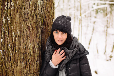 Girl in winter forest Stock Photo