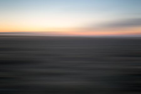 Abstract field at sunset. Motion blur abstract background with horizontal stripes Stock Photo