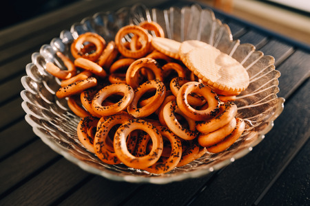 baranka: Bagels with poppy seeds on a plate on the black table