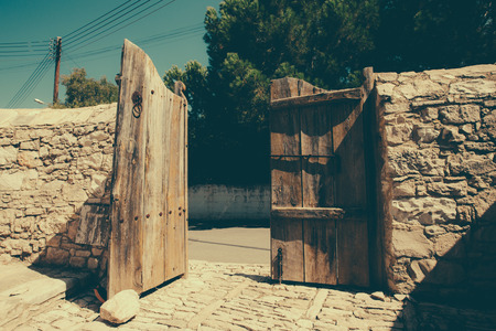 large doors: Old wooden gate in the village Laneia, Cyprus