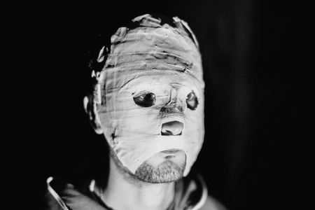 maniac: Black and white photo of a maniac in a mask closeup. Stock Photo