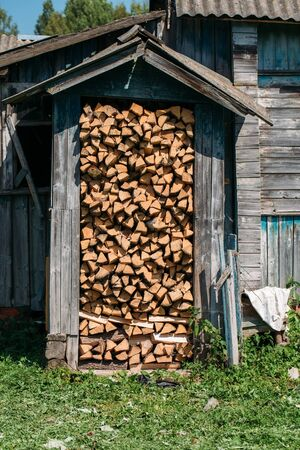 color photo: Color photo close-up firewood shed filled with firewood. Stock Photo
