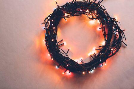 cosiness: Circle from a christmas lamp garland closeup colorful photo.