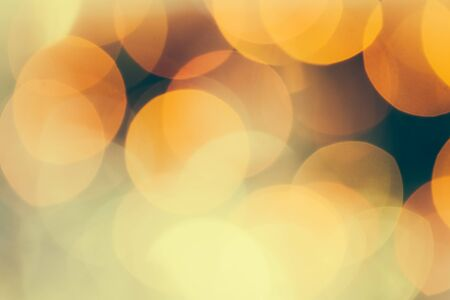 Cream and yellow colors bokeh lights close up.