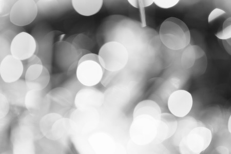 Monochrome black and white bokeh lights background close up.