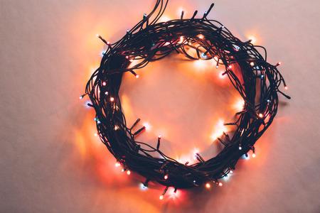 Circle from a christmas lamp garland closeup colorful photo.