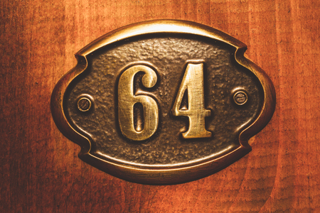sixty: Apartment number sixty four close up colorful photo. Stock Photo