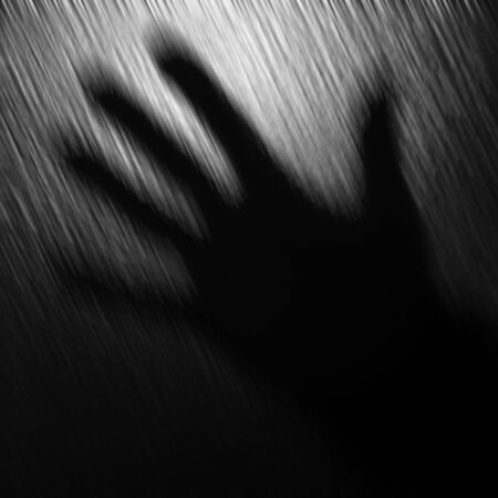 one hand: Abstract blurred black and white background with one hand. Stock Photo
