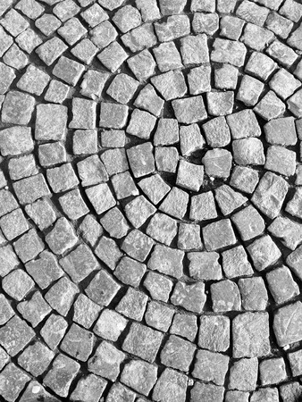 superficial: Pavement flagstone laid in circular pattern dark grey color.