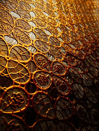 gold textured background: Textured cloth from patterns of gold color. Interior background.