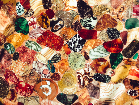 many colored: Many colored stones on a table. Design photo.