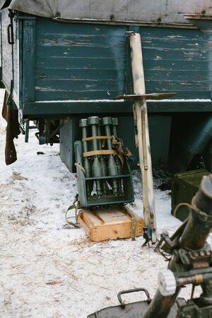 metal box: Green bombs in a metal box near the truck.