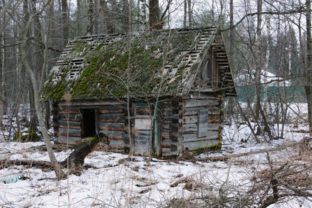 ruinous: Old small abandoned and ruinous country house in russia. Winter time photo. Stock Photo