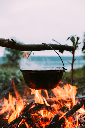 no fires: Fish soup to cook on fire in nature. Outdoors photo.