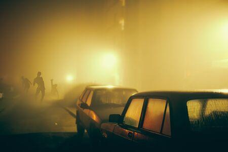 Varios zombi en la calle por la noche. Foto de archivo