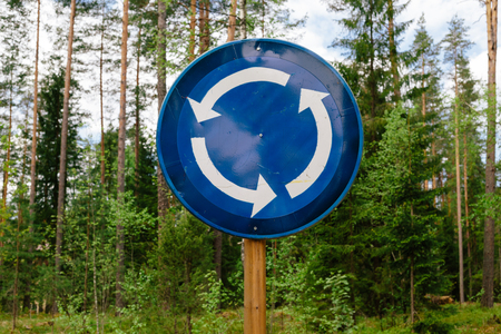 roundabout: Roundabout sign in the wood. Daytime photo. Stock Photo