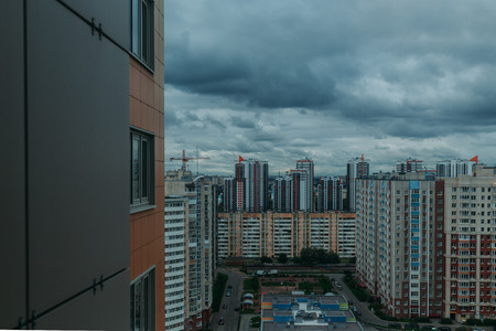 multi story: Multi-storey residential buildings, sleeping area. movement of clouds on a background of urban buildings.