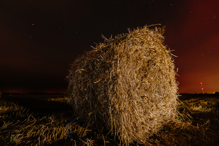 Roll of hay close-up long exposure night photo