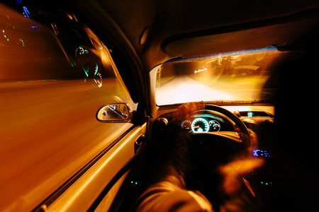 accelerated: Driving at night. View from inside the car. Photo with a long exposure. Taken with a wide-angle optics.