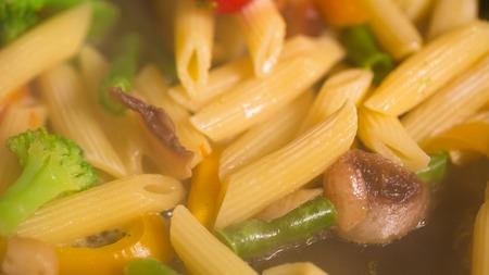 primavera: Primavera Pasta with mushrooms cooking in a pan closeup Stock Photo
