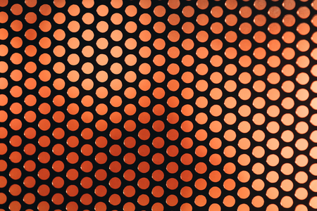 repetition row: Perforated grating on the background color blurred abstract backdrop