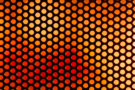 repetition row: speaker grille. Perforated grating on the background color blurred abstract backdrop Stock Photo