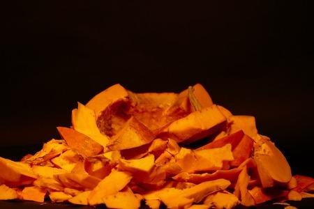 how to make jack o lantern. big orange pumpkin on a black background Stock Photo