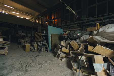 plaster board: Factory for Production of plaster molds. The cluttered, dusty old warehouse at night
