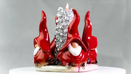 ceramic gnomes Stand for candles Stock Photo