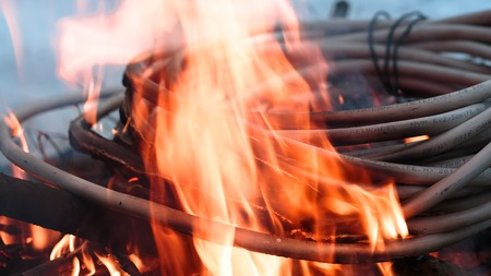 wires on fire. Firing winding insulation of electrical wiring in the fire close-up Stock Photo