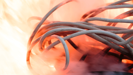 wires on fire. Firing winding insulation of electrical wiring in the fire close-up Banco de Imagens