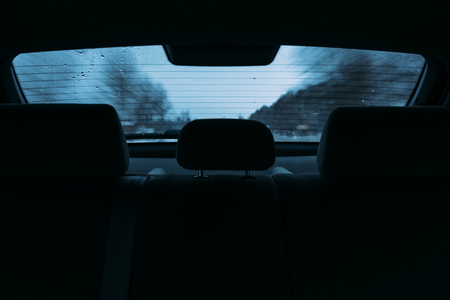 driving a car in the view the rear window. inside the car Imagens