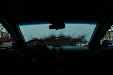 thawing: Car Windshield thawed Snow Thawing On A Windshield Of A Car view from the passenger compartment Stock Photo