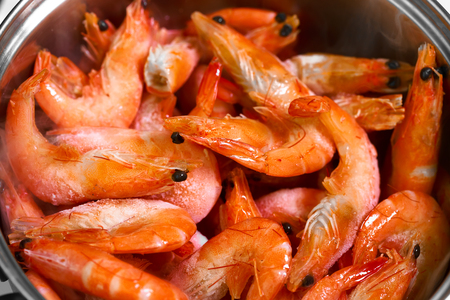 sapid: Many red shrimp in the pan. Close up photo.