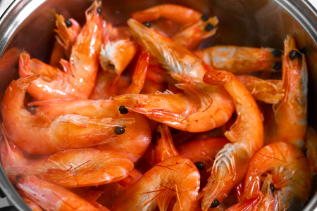 Many red shrimp in the pan. Close up photo.