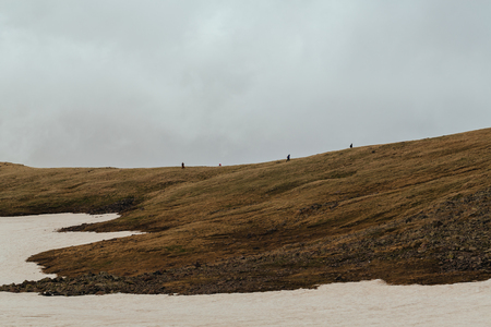 People on the ridge of the mountain of Aragats, Armenia
