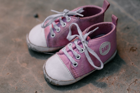 old photo: Old baby sneakers closeup photo.