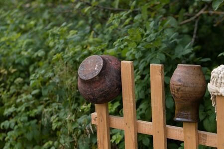 cast-iron bowler on a wooden fence