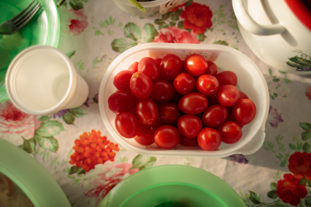 cherry tomatoes in a white container served on a table top view