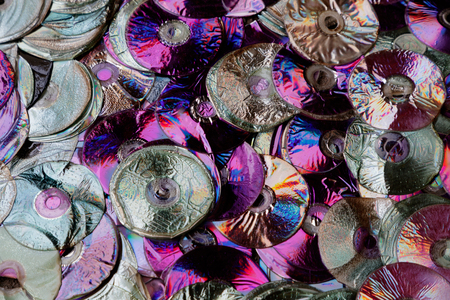 fused compact disk a lot of background Imagens