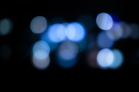 abstract bokeh reflection on a dark background