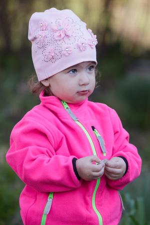 shy child on the street Stock Photo