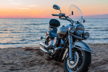 motorcycle on a sandy beach on the background of the sea