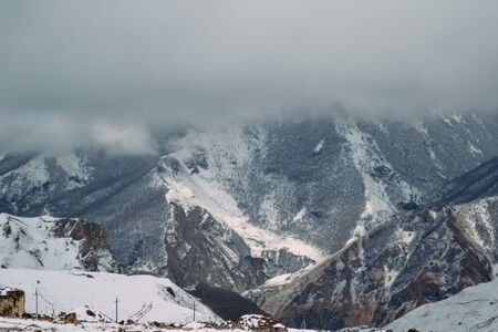 landscape of high mountains covered with snow