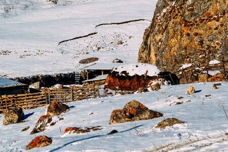 farm in a rocky and snowy area covered with snow