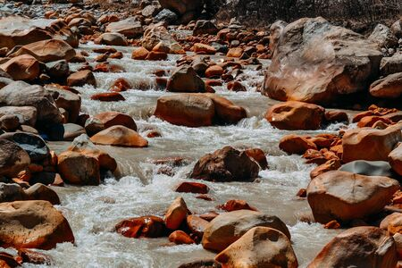current of the river on mountain rocks in the daytime