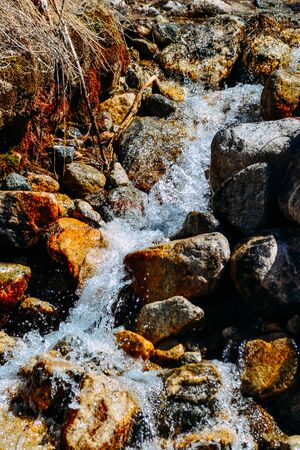 current of the river on mountain rocks in the daytime. Imagens